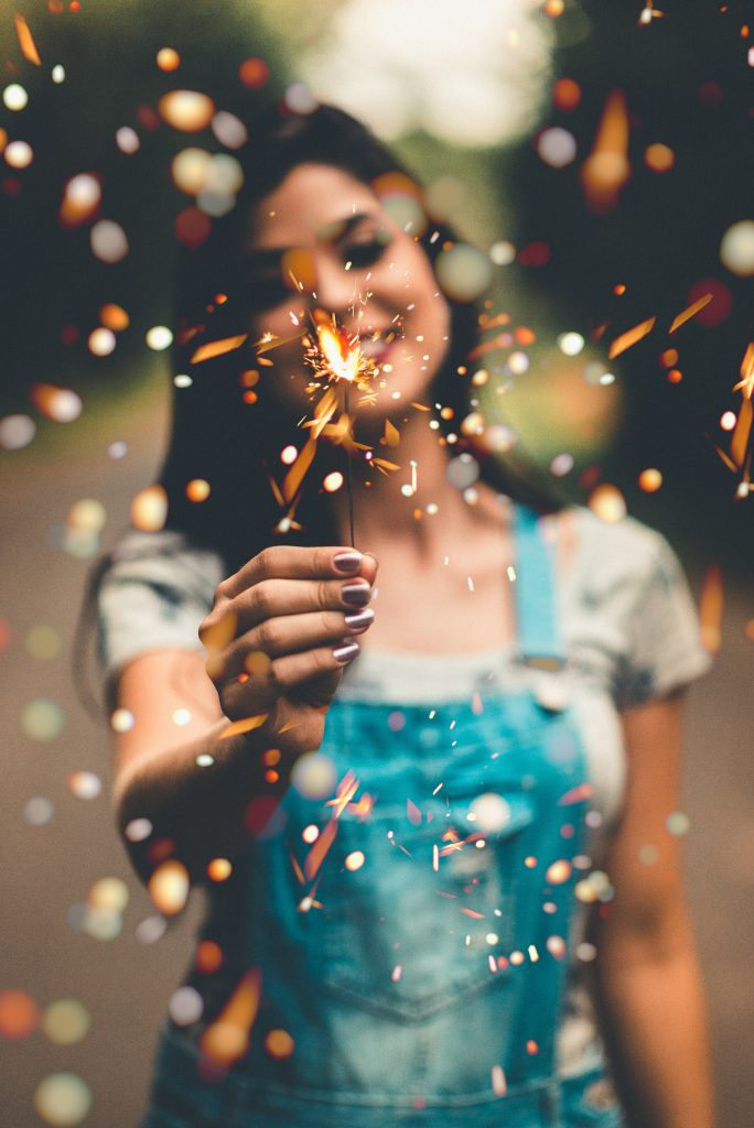 Girl holding a sparkler for New Year's celebration